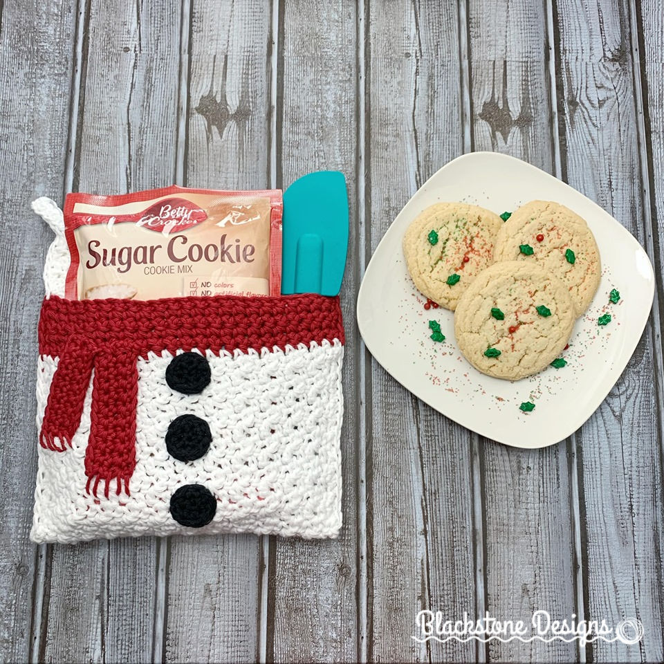 Snowman Belly Crochet Pot Holder. White with red scarf and black crochet buttons.